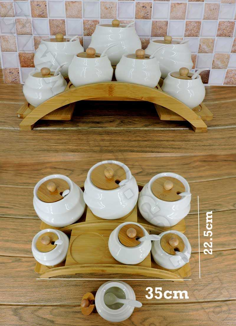 set of 7 cruets with bamboo base